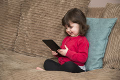 Young girl having fun with Tablet stock images