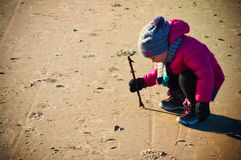 Young girl having fun on winter Baltic beach stock images
