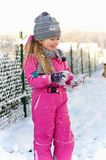 Young girl having fun in winter Stock Photos