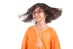 Young Girl Having Hair Fun IV. Young Asian Malay girl having fun with her hair wearing a traditional Malay dress the baju kurung Royalty Free Stock Photo