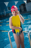 Young girl having a head ache in the pool Royalty Free Stock Photos