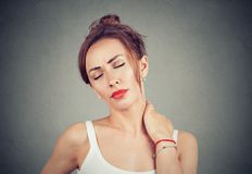 Young girl having pain in neck Stock Photography