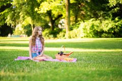Young girl having a picnic in park Stock Images