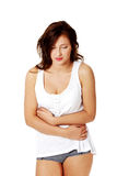 Young girl having a stomachache. Royalty Free Stock Photo