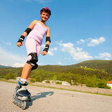 Young girl having troubles on rollerskates Royalty Free Stock Photos
