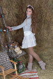 Young girl in the hayloft Royalty Free Stock Photography