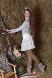 Young girl in the hayloft Stock Images