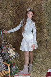 Young girl in the hayloft Royalty Free Stock Images