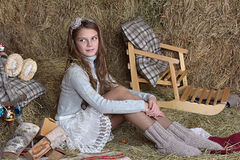 Young girl in the hayloft Stock Photo