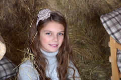 Young girl in the hayloft Stock Photos