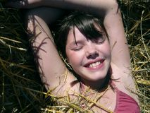 Young girl in haystack Royalty Free Stock Photography