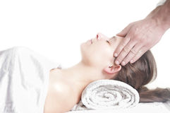 Young girl head massage spa. Young attractive girl having head massage at spa resort Royalty Free Stock Images
