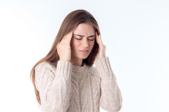 Young girl with headache keeps hands whiskey isolated on white background Royalty Free Stock Photos