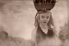 Young girl headdress. Girl headdress Indian fog vintage Royalty Free Stock Images