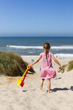Young girl heading for the beach Royalty Free Stock Images