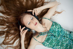 The young girl with headphones Royalty Free Stock Photos