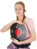Young girl with a headphones. Young girl with a vinyl record and headphones Stock Photos