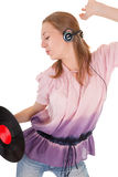 Young girl with a headphones. Young girl with a vinyl record and headphones Royalty Free Stock Images