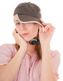 Young girl with a headphones. Young girl with a baseball cap and headphones Royalty Free Stock Photo