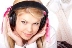 Young girl in headphones Stock Photos