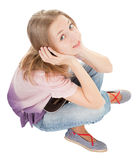 Young girl with a headphones. Young girl with a baseball cap and headphones Royalty Free Stock Photography