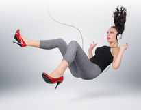 Young girl with headphones. In unreal pose (concept Stock Photo