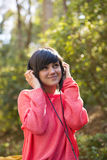Young girl with headphones. Looking at camera Royalty Free Stock Photo