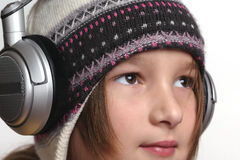Young girl and headphones. White background Royalty Free Stock Photo