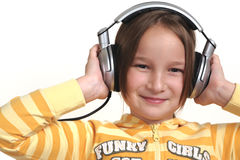 Young girl and headphones. White background Royalty Free Stock Photography