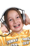 Young girl and headphones. White background Royalty Free Stock Images