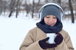 Young girl with headphones and coffee cup Royalty Free Stock Photos