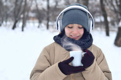 Young girl with headphones and coffee cup Stock Image
