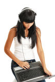 The young girl in headphones with a computer Royalty Free Stock Photography