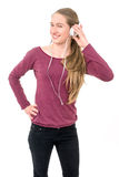 Young girl with headphones dancing; on white background Royalty Free Stock Photo