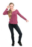 Young girl with headphones dancing; on white background Royalty Free Stock Photos