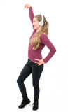 Young girl with headphones dancing; on white background Royalty Free Stock Photography