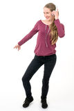 Young girl with headphones dancing; on white background Stock Image