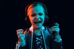 Young girl with headphones enjoying music stock photography