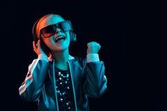 Young girl with headphones enjoying music royalty free stock image