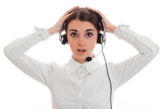 Young girl in headphones with great surprise keeps your hands behind your head and looks directly Stock Images