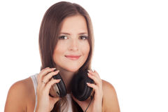 Young girl with headphones in hand. Closeup portrait young girl with headphones in hand Royalty Free Stock Photos