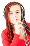 Young girl with headphones keeping silence Royalty Free Stock Image