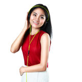 Young girl with headphones listening music Royalty Free Stock Image