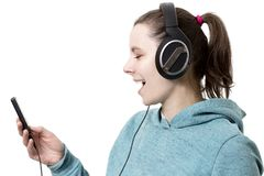 Young girl in headphones with player in hands listening to pop m. Usic isolated on white background. woman listens to modern music. Singing in headphones with Royalty Free Stock Image