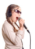 A young girl with headphones singing Royalty Free Stock Photo