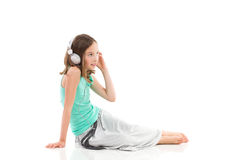 Young girl with a headphones Royalty Free Stock Photos