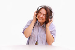 A young girl with headphones smiling Stock Photography