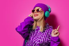 Young girl with headphones in sports jacket stock image