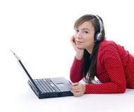 Young girl in headphones working on laptop Stock Photography