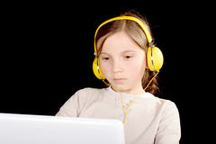 A young girl with headphones Stock Image